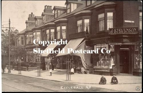 spc597: Ecclesall Rd (Jn Harefield Rd) (2 boys seated x-legged on pavenment)